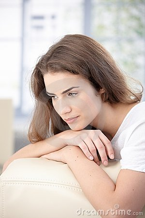 Free Attractive Girl Daydreaming On Sofa At Home Royalty Free Stock Images - 17626329