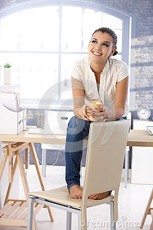 Free Attractive Girl Daydreaming On Top Of Desk Smiling Stock Image - 33480771