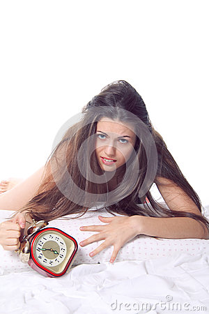 Desperate girl with old alarm clock