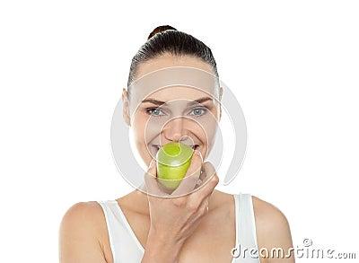 Attractive girl eating fresh juicy green apple