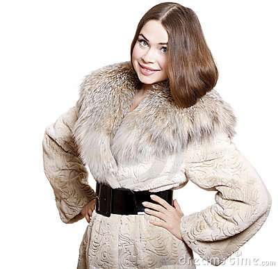 Attractive girl in a fur coat