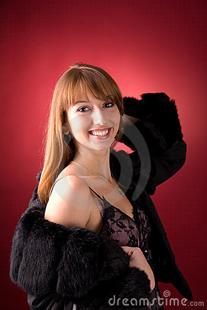 Attractive girl in fur coat