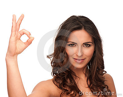 Attractive girl gesturing OK sign