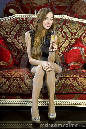 Attractive girl with glass of fizz