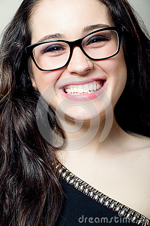 Attractive girl with glasses laughing