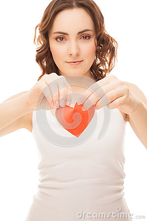 Attractive girl holding broken paper red valentine heart focus o