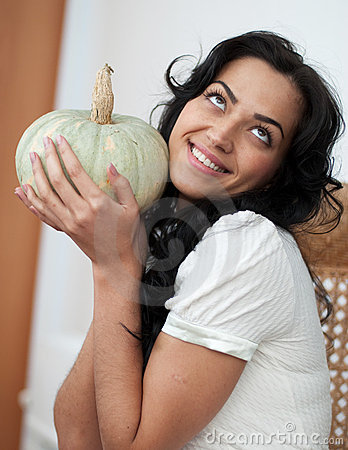 Free Attractive Girl Holding Pumpkins And Smiling Stock Image - 12134851