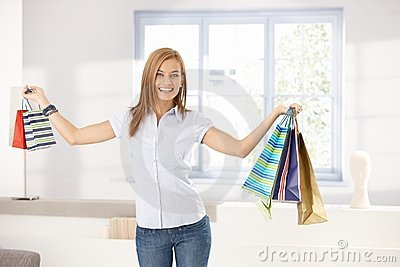 Attractive girl holding shopping bags smiling