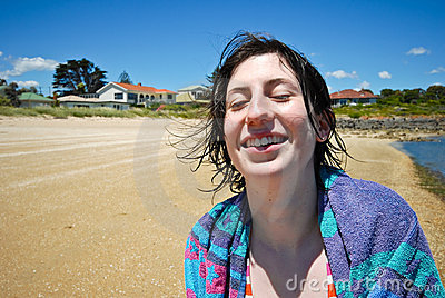 Attractive Girl Laughing On Beach