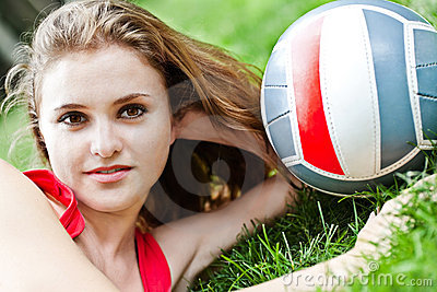 Attractive girl lay on grass