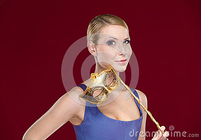 Attractive girl with masquerade masque