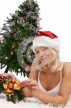 Attractive girl near christmas tree