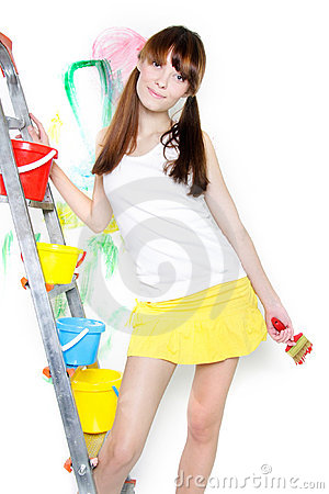 Attractive girl with paintbrush