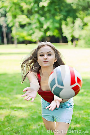 Attractive girl play with ball