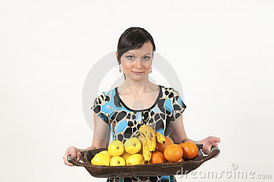 Attractive girl portrait with fruits