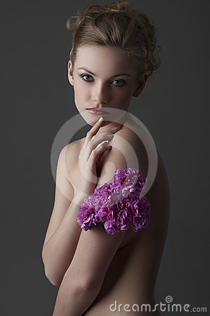 Attractive girl portrait with purple carnation