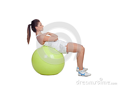 Attractive girl practicing abdominal on a big ball