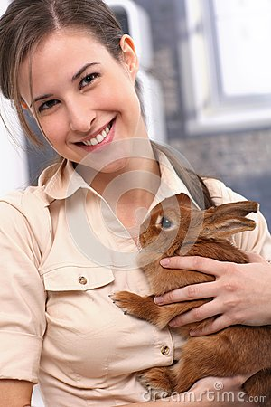 Attractive girl with rabbit