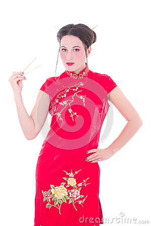 Attractive girl in red japanese dress with chopsticks isolated o