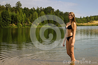 Attractive girl relaxing by the river