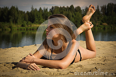 Attractive girl on a sandy beach