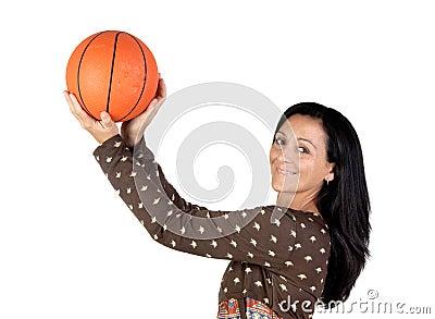 Attractive girl shooting basketball