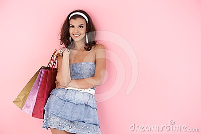 Attractive girl with shopping bags at summer