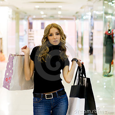 Attractive girl in shopping mall