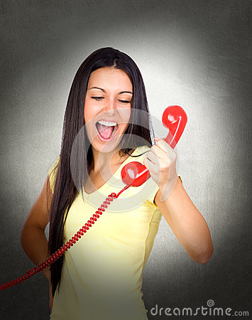 Attractive girl shouting at phone