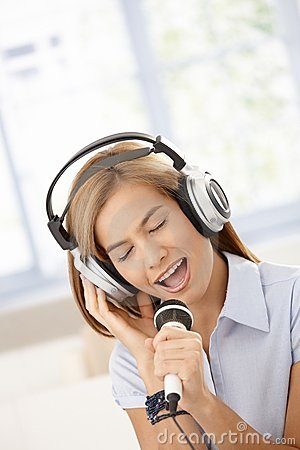 Attractive girl singing eyes closed