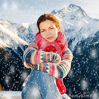 Attractive girl in snowy winter Alps