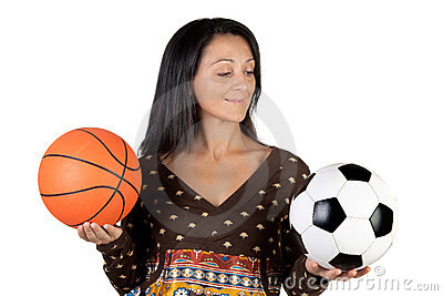 Attractive girl with soccer and basket ball