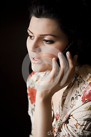 Attractive girl talking over the cell phone.