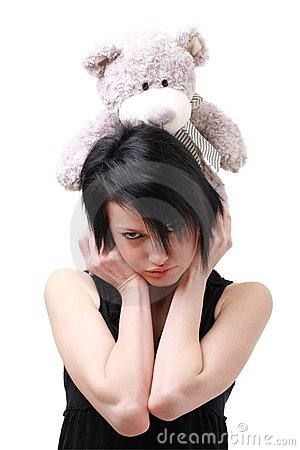 Attractive girl with toy bear