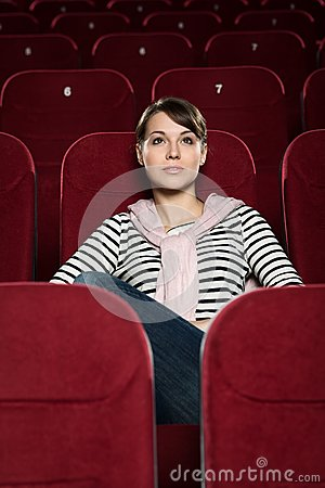 Attractive girl watching movies