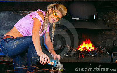 Attractive girl in workshop with instrument