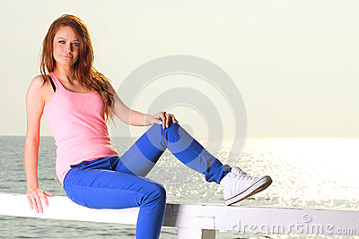 Attractive girl Young woman looking at sea