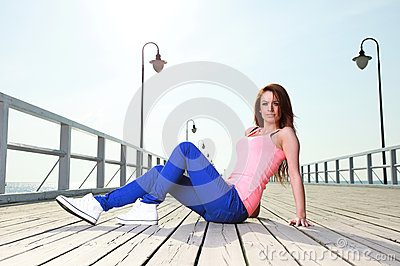 Attractive girl Young woman pier sea