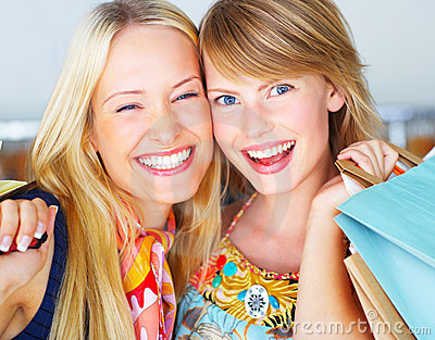Attractive girls happy out shopping two
