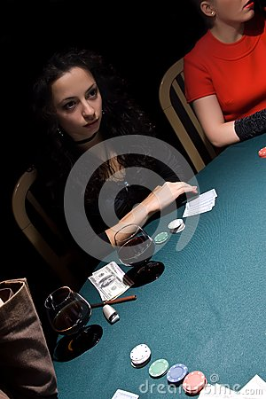 Attractive girls playing poker