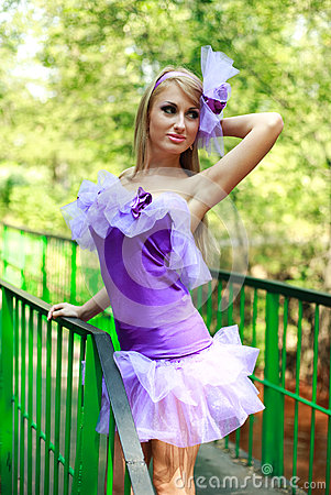 Attractive glamorous girl, posing in violet
