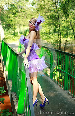 Attractive glamorous young girl in violet