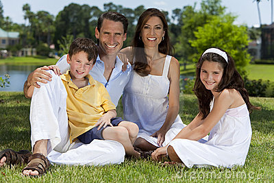 Attractive Happy Family Sitting Outside