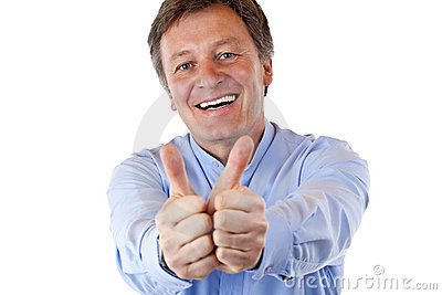 Attractive happy pensioner shows both thumbs up