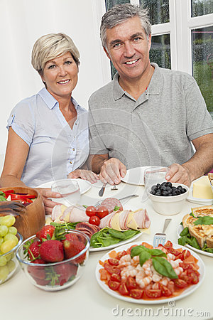 Middle Aged Couple Healthy Eating Salad Table