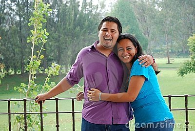 Attractive Hispanic Couple laughing