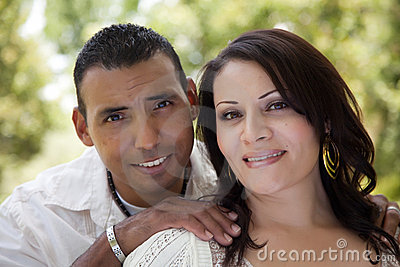 Attractive Hispanic Couple in the Park