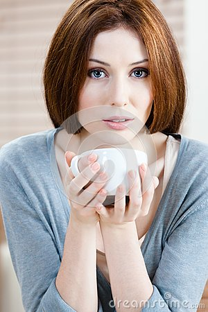 Attractive lady with cup of tea