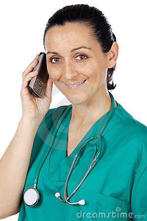 Attractive Lady Doctor speaking on the telephone