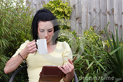 An attractive lady reading a book